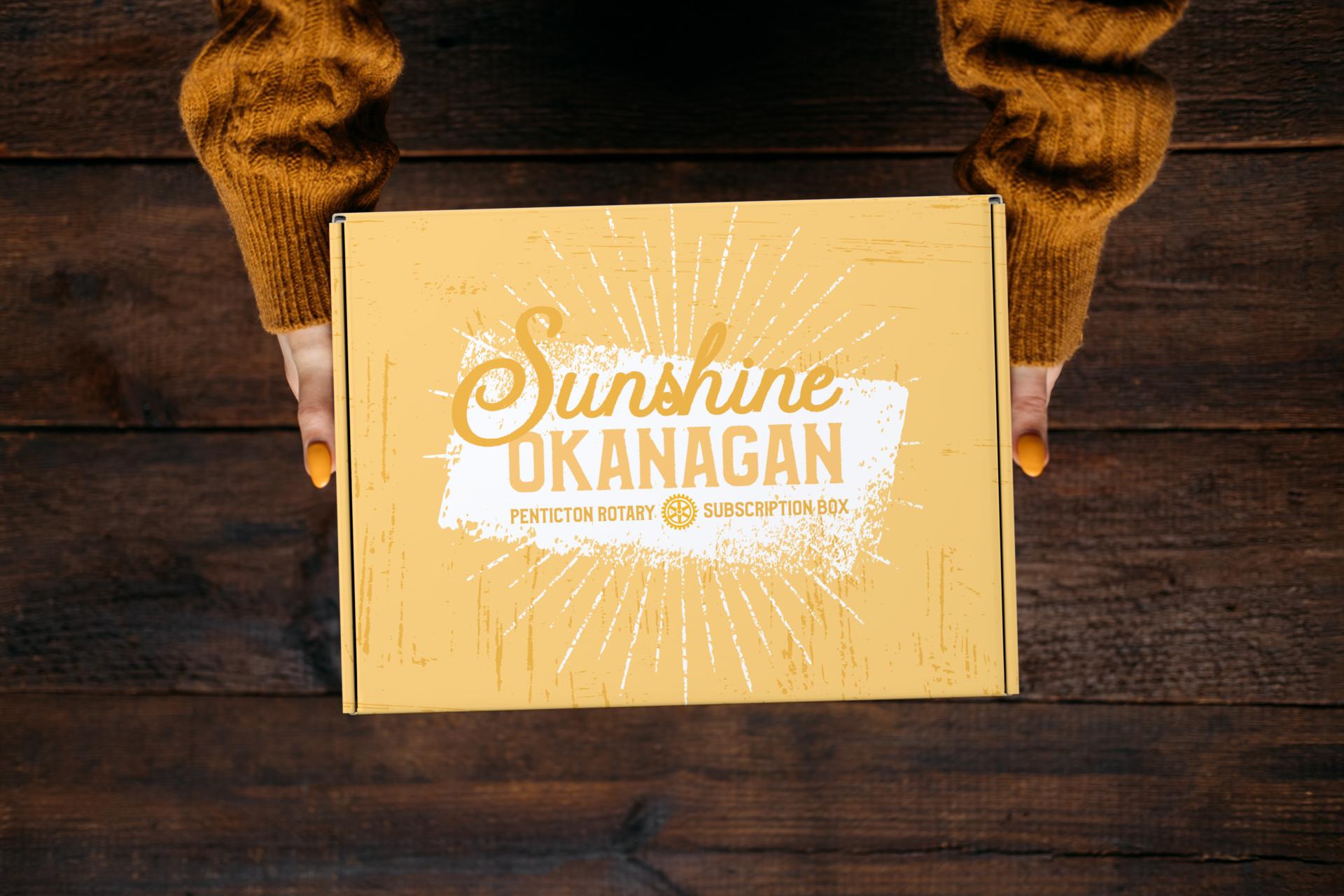 women holding Sunshine Okanagan subscription box